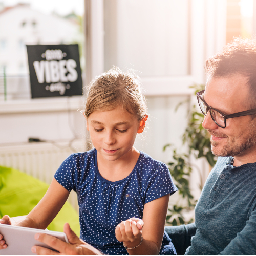 Child and father choosing school meals online
